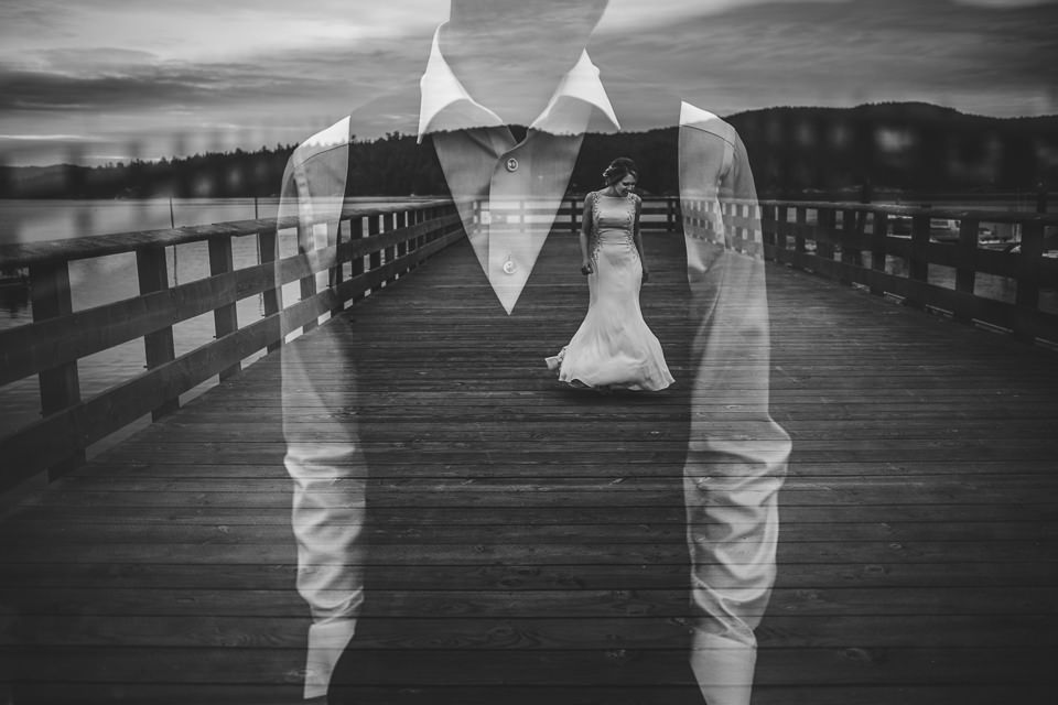 A black and white image of a grooms torso with the bride over his heart in a multiple expore